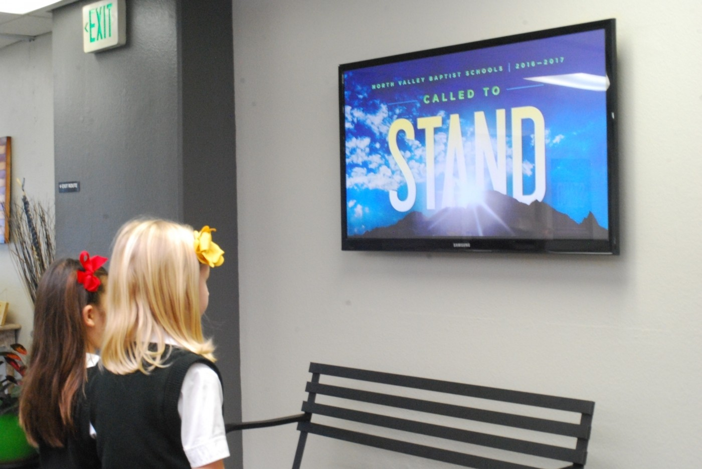 two school children looking at a screen